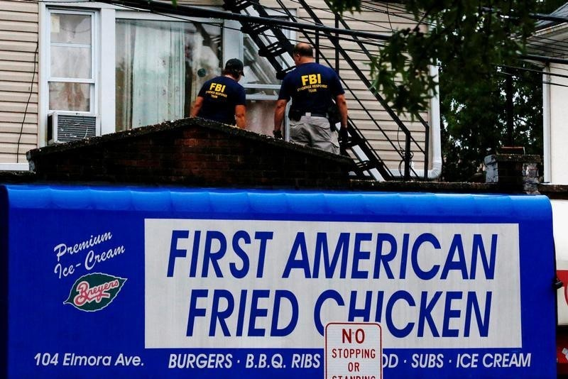 Federal Bureau of Investigation (FBI) personnel search an address during an investigation into Ahmad Khan Rahami, who was wanted for questioning in an explosion in New York, which authorities believe is linked to the explosive devices found in New Jersey