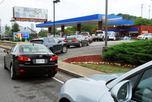 Vehicles wait in line for gas at a Twice Daily gas station on Franklin Road in Brentwood, Tennessee, U.S.