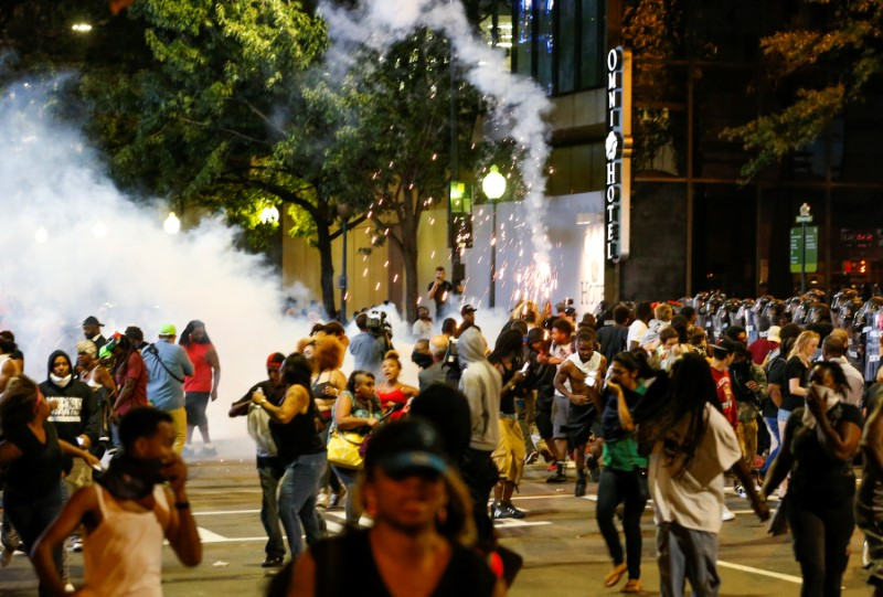 People running from flash bang grenades at Charlotte riot