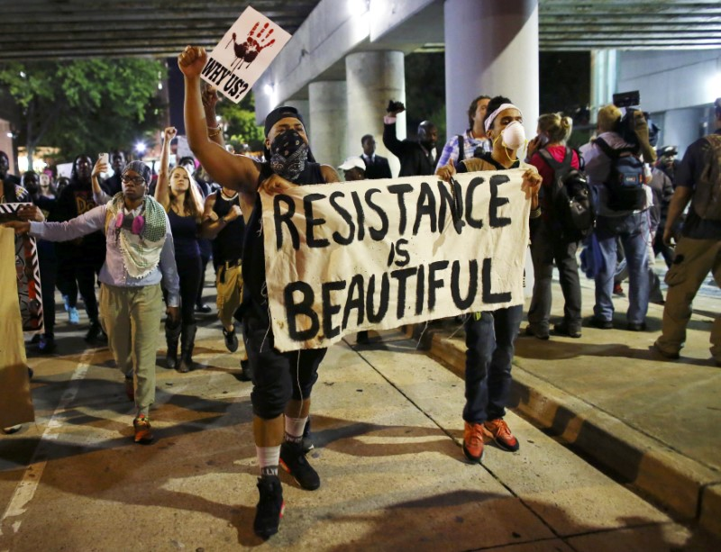 Protesters walk in the streets downtown during another night of protests over the police shooting of Keith Scott in Charlotte