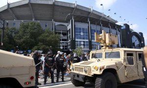 The National Guard arrives as people gather outside the football stadium as the NFL's Carolina Panthers host the Minnesota Vikings, to protest the police shooting of Keith Scott, in Charlotte, North Carolina