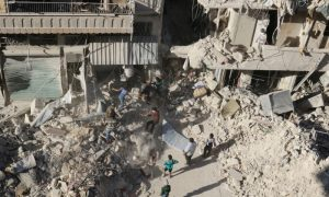 People dig in the rubble in an ongoing search for survivors at a site hit previously by an airstrike in the rebel-held Tariq al-Bab neighborhood of Aleppo,