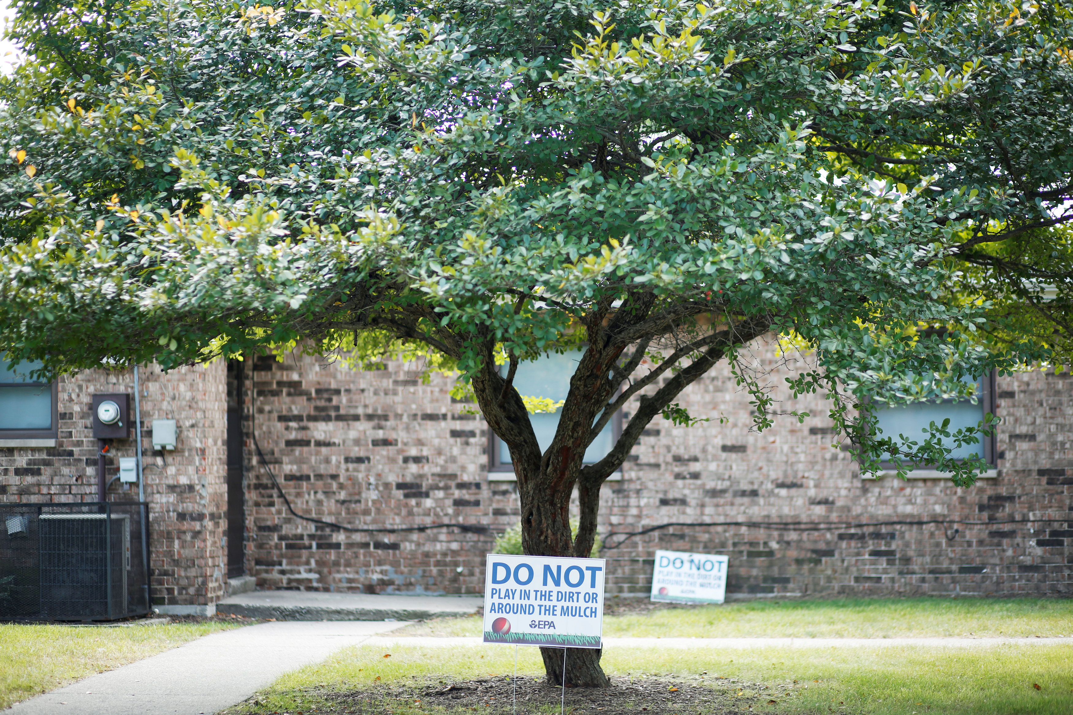 "Environmental Protection Agency signs that read ""DO NOT play in the dirt or around the mulch"" are seen at the West Calumet Complex in East Chicago, Indiana,"