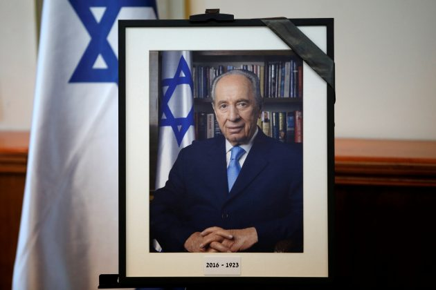 A photograph of former Israeli President Shimon Peres is displayed before the start of a special cabinet meeting to mourn the death of Peres, in Jerusalem