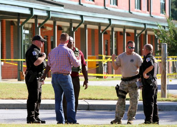 Police officers investigate the scene of the shooting in the South Carolina Elementary school