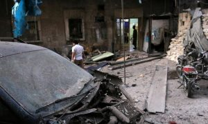 Medics inspect the damage outside a field hospital after an airstrike in the rebel-held al-Maadi neighbourhood of Aleppo, Syria,