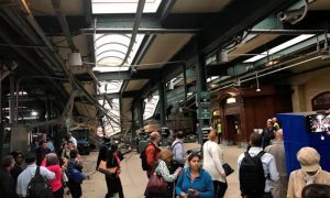 Onlookers view a New Jersey Transit train that derailed and crashed through the station in Hoboken, New Jersey, U.S. in this picture courtesy of David Richman taken