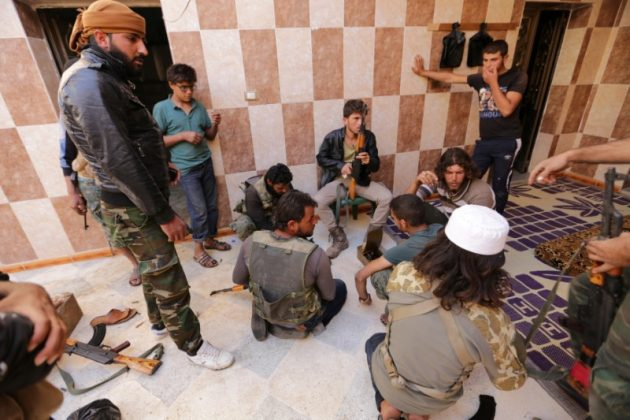 Rebel fighters of 'Al-Sultan Murad' brigade gather on the outskirts of the northern Syrian town of Shawa, which is controlled by Islamic State militants, in Aleppo Governorate, Syria,