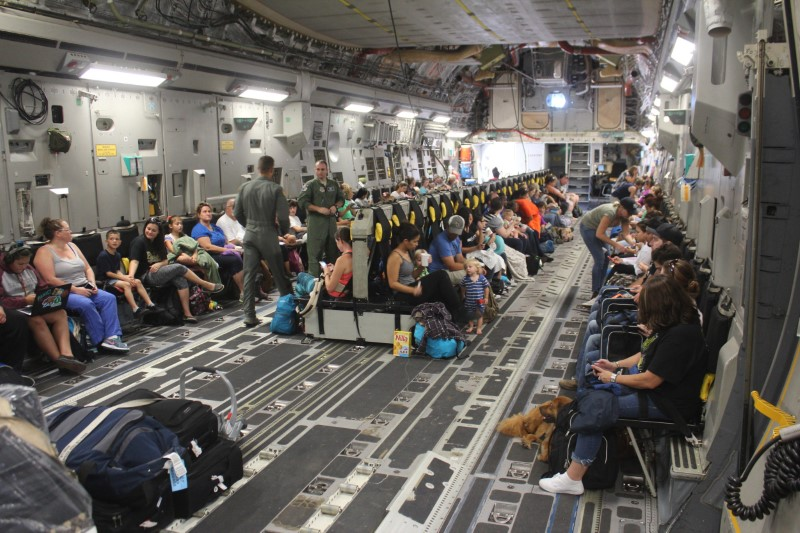 Families aboard a plane to evacuate them