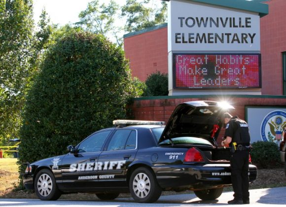 n Anderson County sheriff's deputy stands outside of Townville Elementary School after a shooting in Townville, South Carolina,