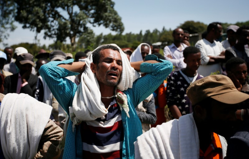 A man mourns during the funeral of Tesfu Tadese Biru, 32, a construction engineer who died during a stampede after police fired warning shots at an anti-government protest in Bishoftu during Irreecha, the thanksgiving festival of the Oromo people, in Denkaka Kebele