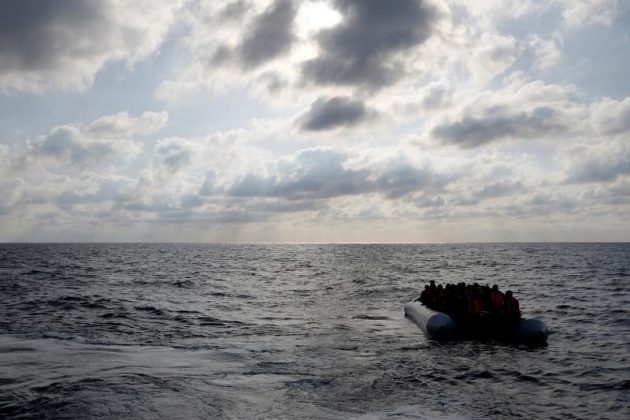 Migrants in a dinghy await rescue around 20 nautical miles off the coast of Libya,