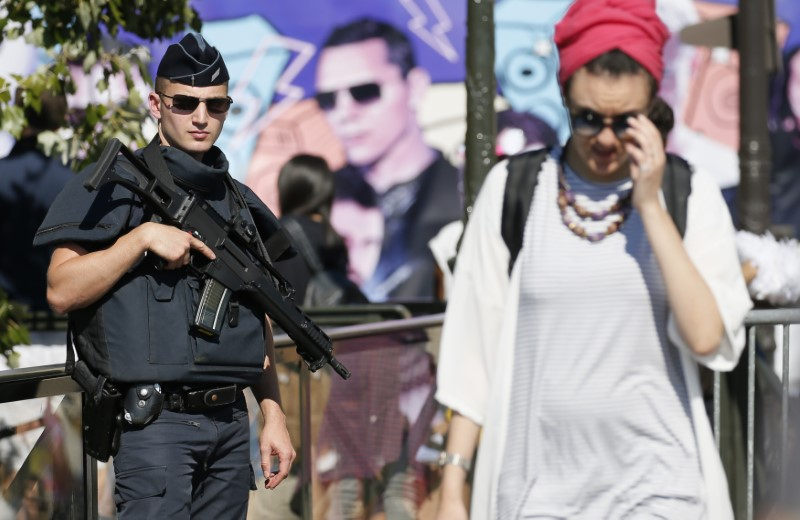 Armed French police stand guard during the18th edition of the Techno Parade music event in Paris