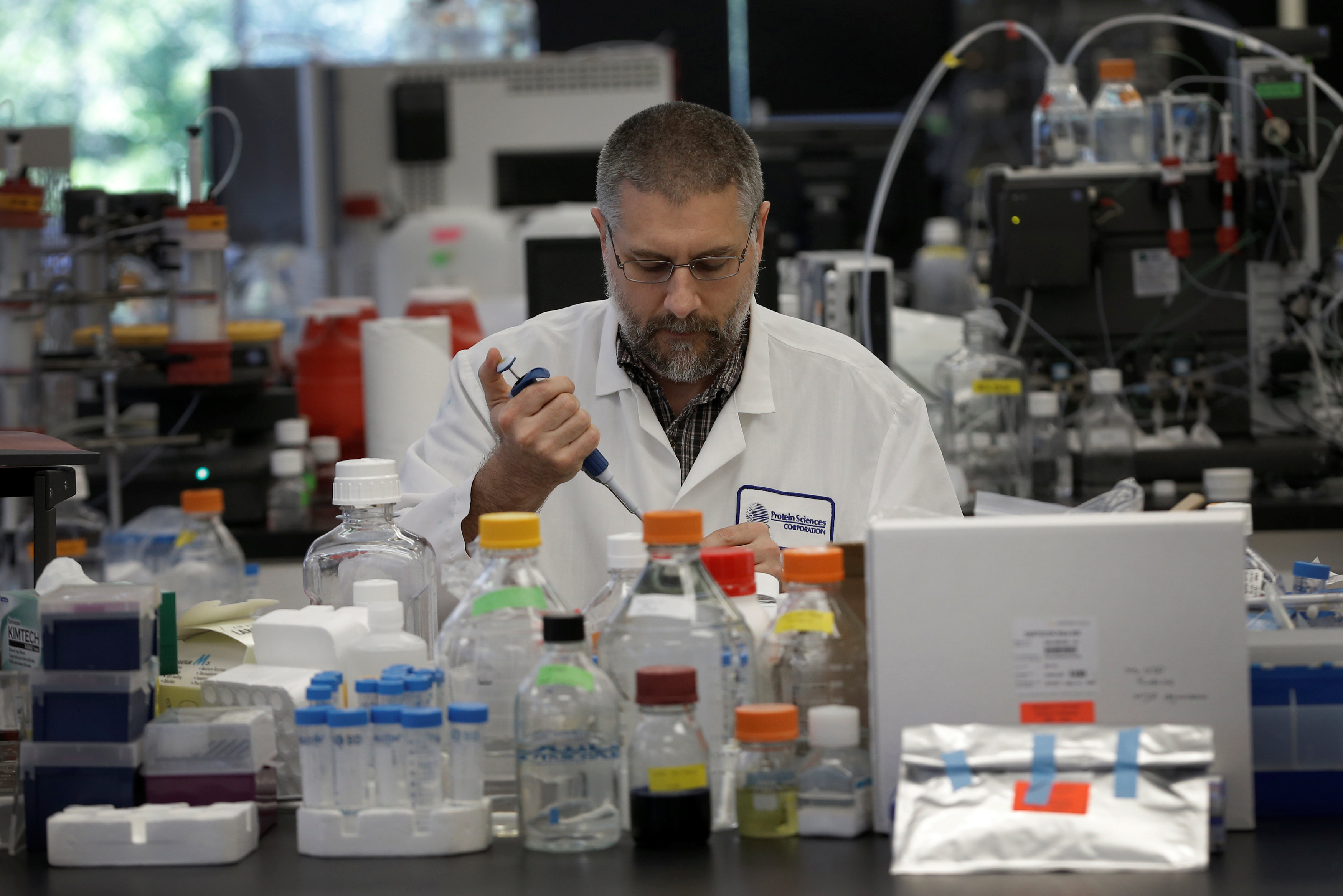 Research scientist Dan Galperin works in the research laboratory at Protein Sciences Inc. where they are working on developing a vaccine for the Zika virus i