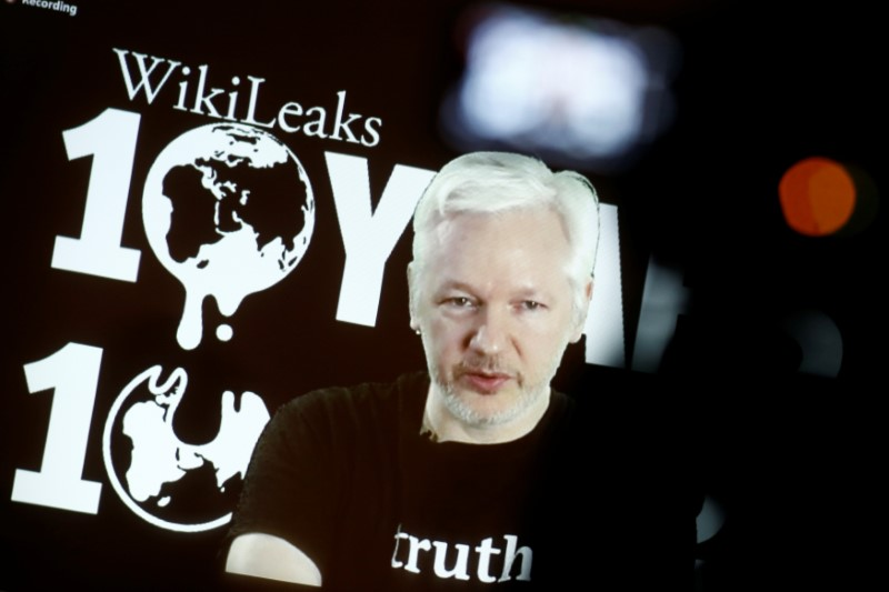Julian Assange, Founder and Editor-in-Chief of WikiLeaks speaks via video link during a press conference on the occasion of the ten year anniversary celebration of WikiLeaks in Berlin, Germany,