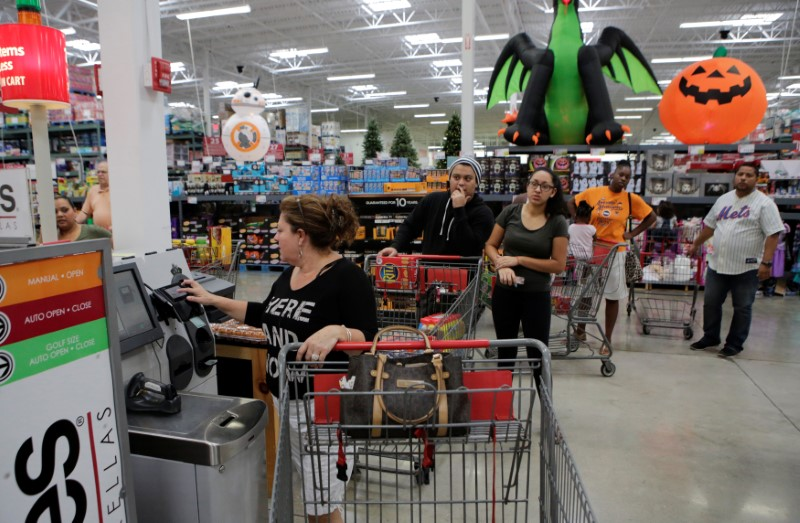 People queue as they flock to the supermarket to take care of last minute shopping in anticipation of Hurricane Matthew, in Coral Springs, Florida,