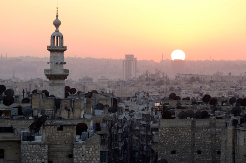 The sun sets over Aleppo as seen from rebel-held part of the city