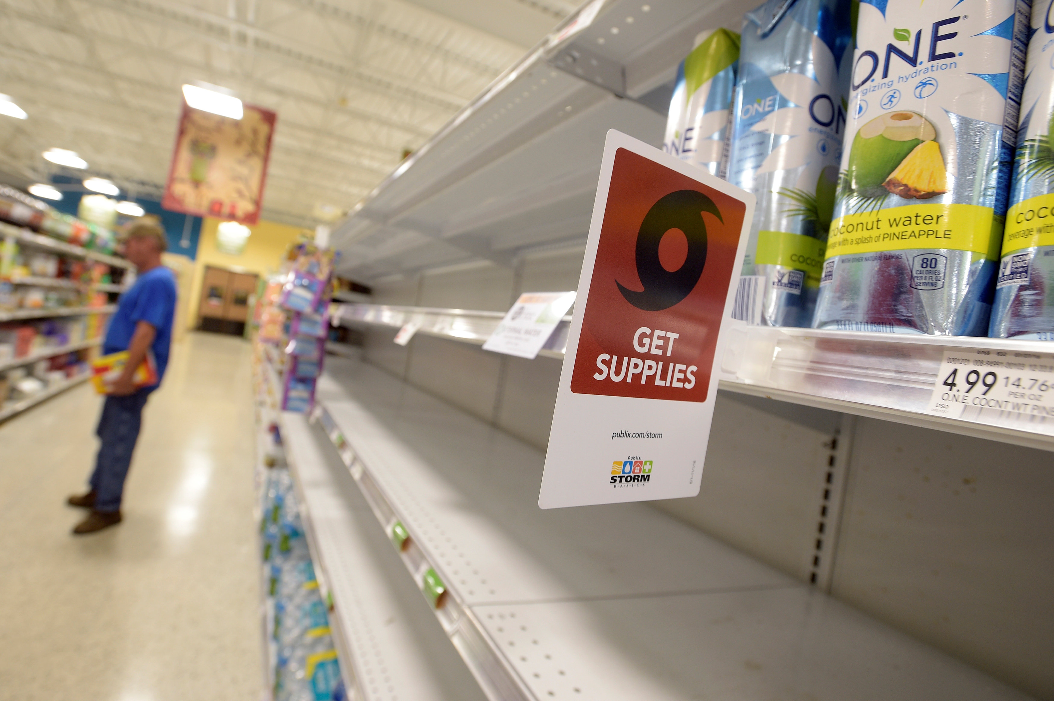 Shelves formerly holding water bottles sit empty at a supermarket before the arrival of Hurricane Matthew in South Daytona, Florida, U.S.,