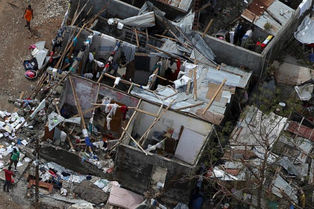 People try to rebuild their destroyed houses after Hurricane Matthew passes Jeremie, Hait