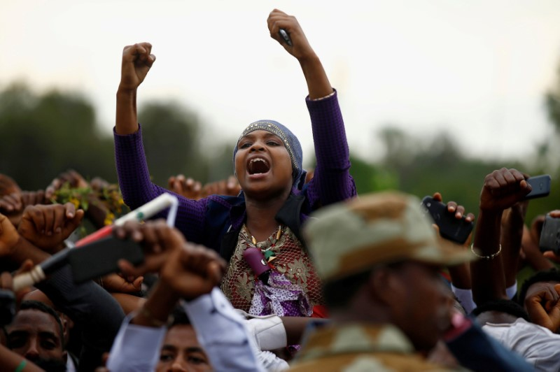 Demonstrators chant slogans while flashing the Oromo protest gesture during Irreecha, the thanksgiving festival of the Oromo people, in Bishoftu town, Oromia region, Ethiopia,