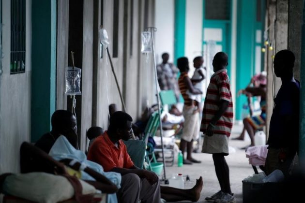 Relatives and patients treated for cholera after Hurricane Matthew in the Hospital of Port-a-Piment, Haiti,