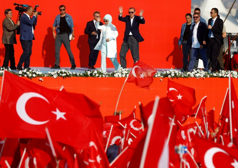 Turkish President Tayyip Erdogan and his wife Emine Erdogan attend Democracy and Martyrs Rally, organized by him and supported by ruling AK Party (AKP), oppositions Republican People's Party (CHP) and Nationalist Movement Party (MHP), to protest against last month's failed military coup attempt, in Istanbul, Turkey