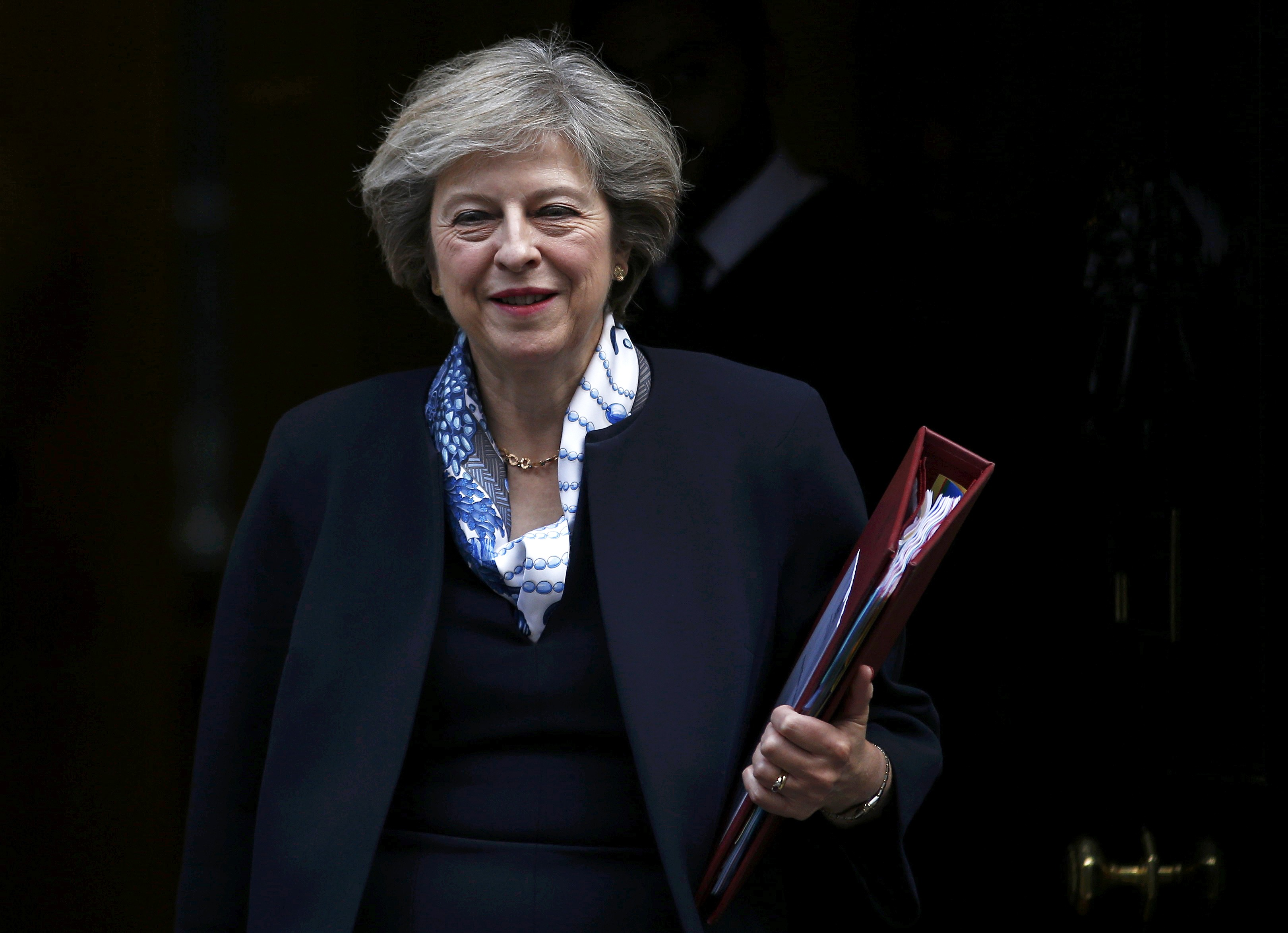 Britain's Prime Minister Theresa May leaves Number 10 Downing Street to attend Prime Minister's Questions at parliament in London, Britain