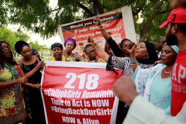Members of the #BringBackOurGirls (#BBOG) campaign stand behind a banner with Number 218 during a sit-out in Abuja, Nigeria May 18, 2016, after receiving news that a Nigerian teenager kidnapped by Boko Haram from her school in Chibok more than two years ago has been rescued.