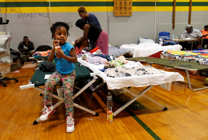 Nazareth Gray (4) sits on the edge of a cot at the Carver Heights Elementary School shelter after her and her grandmother Margaret (not pictured) were displaced by the effects of Hurricane Matthew in Goldsboro, North Carolina,