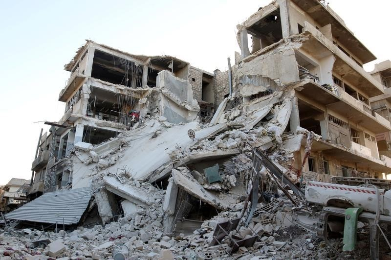 A damaged site is pictured after an airstrike in the besieged rebel-held al-Qaterji neighbourhood of Aleppo, Syria October 14, 2016. REUTERS/Abdalrhman Ismail