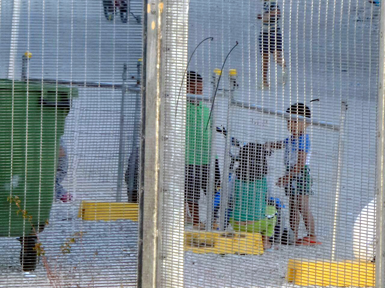 An undated supplied image from Amnesty International claiming to show children playing near a fence at the country's Australian-run detention centre on the Pacific island nation of Nauru
