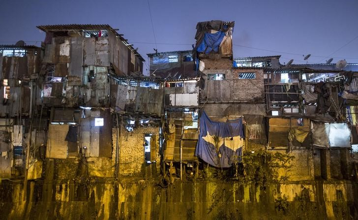 Windows of various shanties in Dharavi, one of Asia's largest slums, are seen in Mumbai