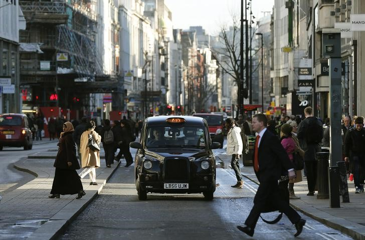 A taxi travels along Oxford Street during a bus strike in London January 13, 2015. Members of the Unite union are staging a 24-hour bus strike over pay and conditions, local media reported.