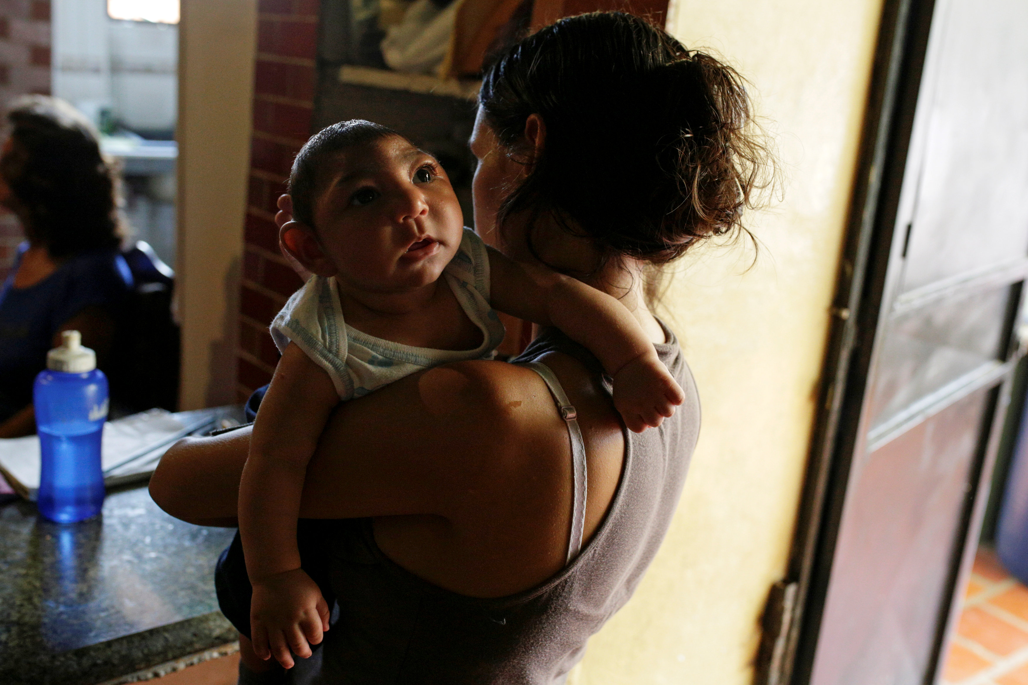 Ericka Torres holds her 3-months old son Jesus, who was born with microcephaly, at their home in Guarenas, Venezuela