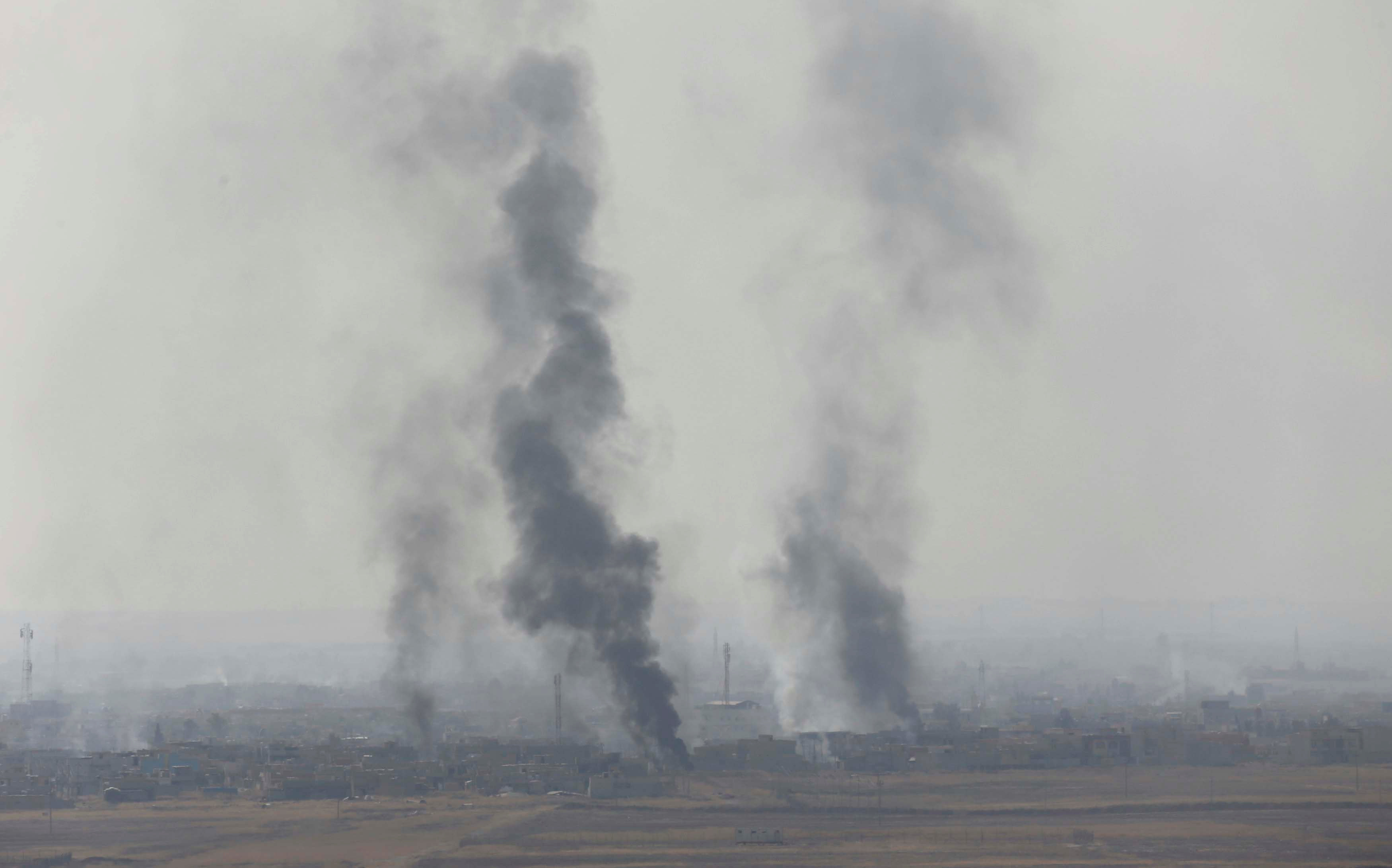Smoke rises from clashes at Bartila in the east of Mosul during clashes with Islamic State militants, Iraq.