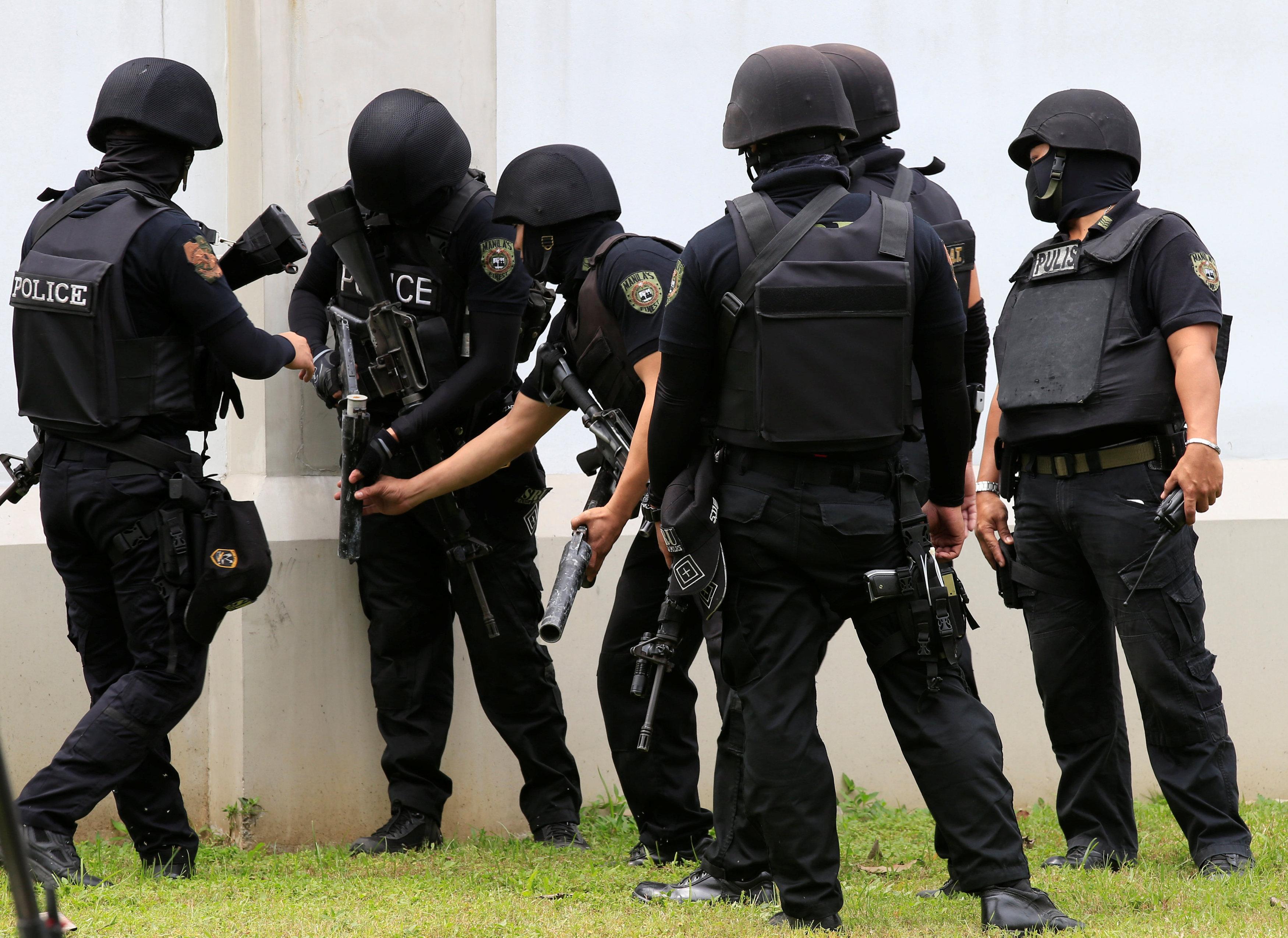 SWAT team prepares tear gas in Philippines