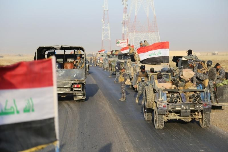 Iraqi security forces advance in Qayara, south of Mosul, to attack Islamic State militants in Mosul, Iraq