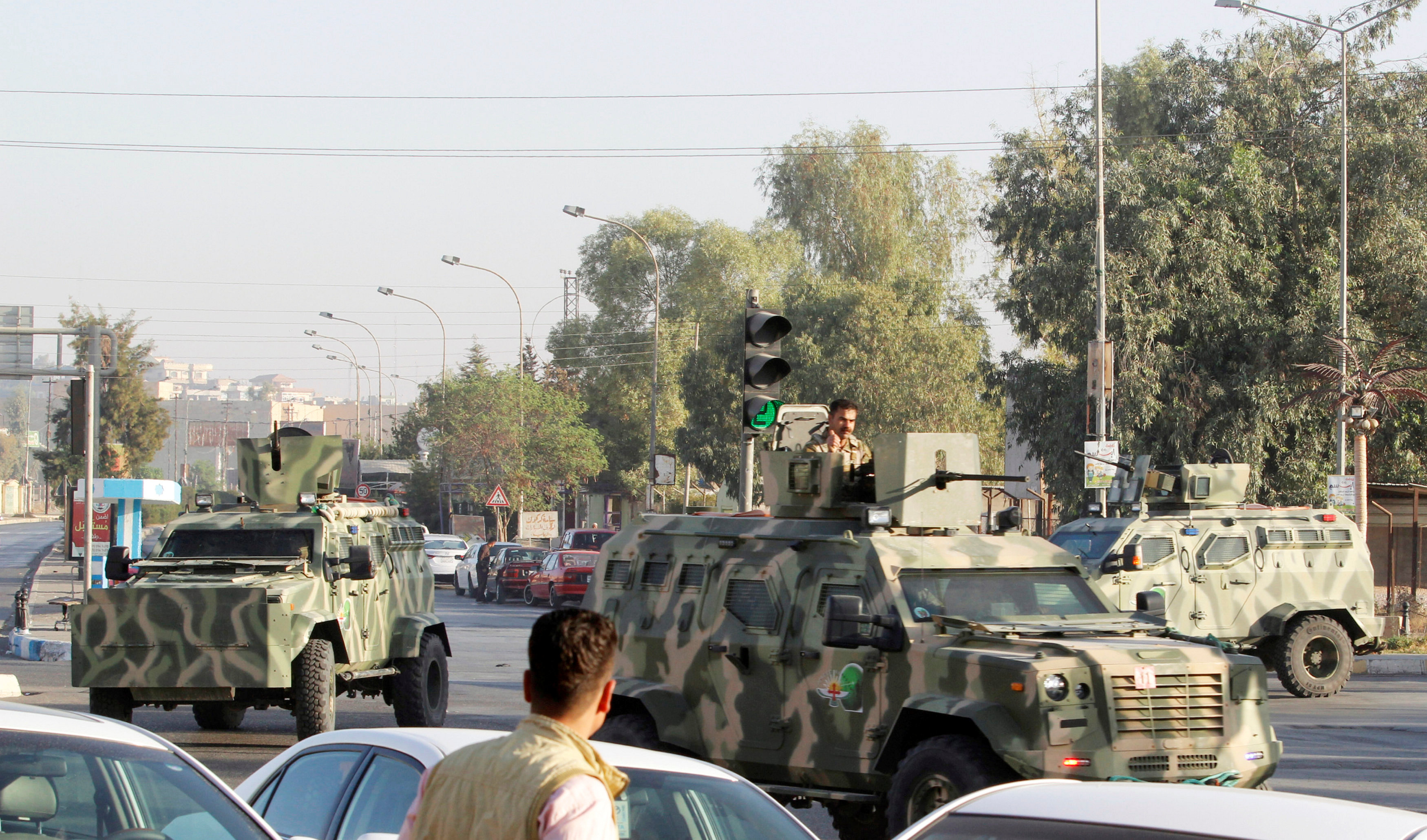 Military vehicles of peshmerga forces are seen at a site of an attack by Islamic State militants in Kirkuk, Iraq,