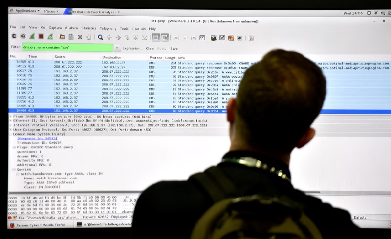 An attendee looks at a monitor at the Parsons booth during the 2016 Black Hat cyber-security conference in Las Vegas, Nevada, U.S