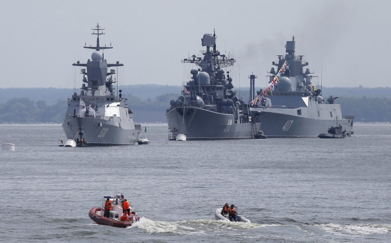 (L-R) Russian navy corvette Steregushchy, destroyer Nastoichivy and frigate Admiral Gorshkov are anchored in a bay of the Russian fleet base in Baltiysk in Kaliningrad region, Russia