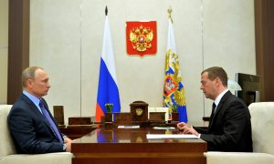 Russian President Vladimir Putin (L) meets with Prime Minister Dmitry Medvedev at the Novo-Ogaryovo state residence outside Moscow, Russia