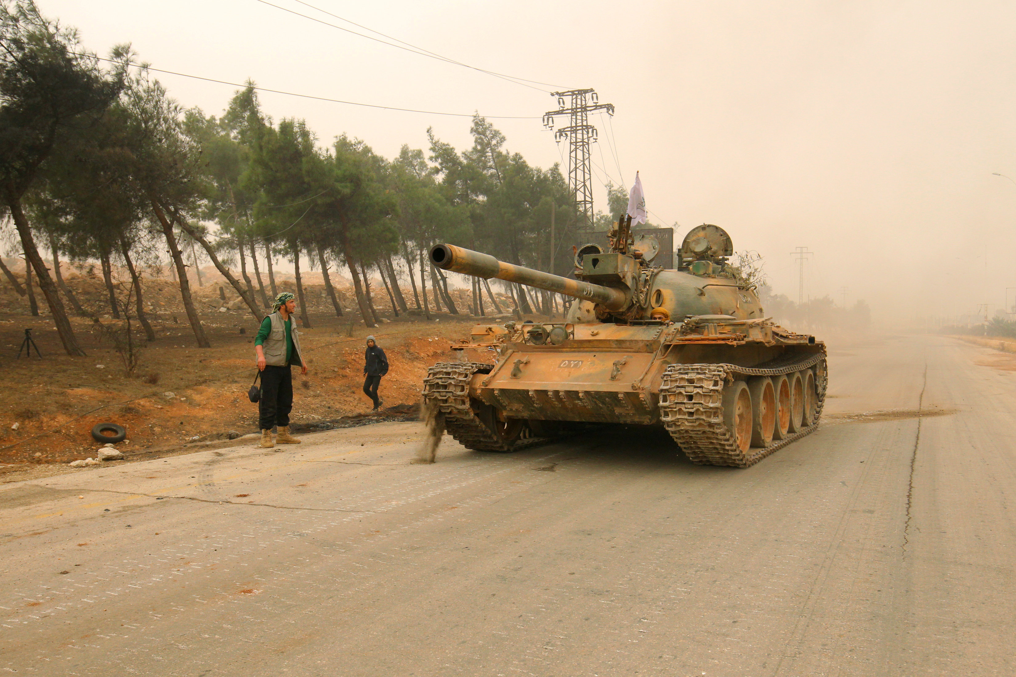 A tank for rebel fighters drives in Dahiyat al-Assad west Aleppo city, Syria October 28, 2016.