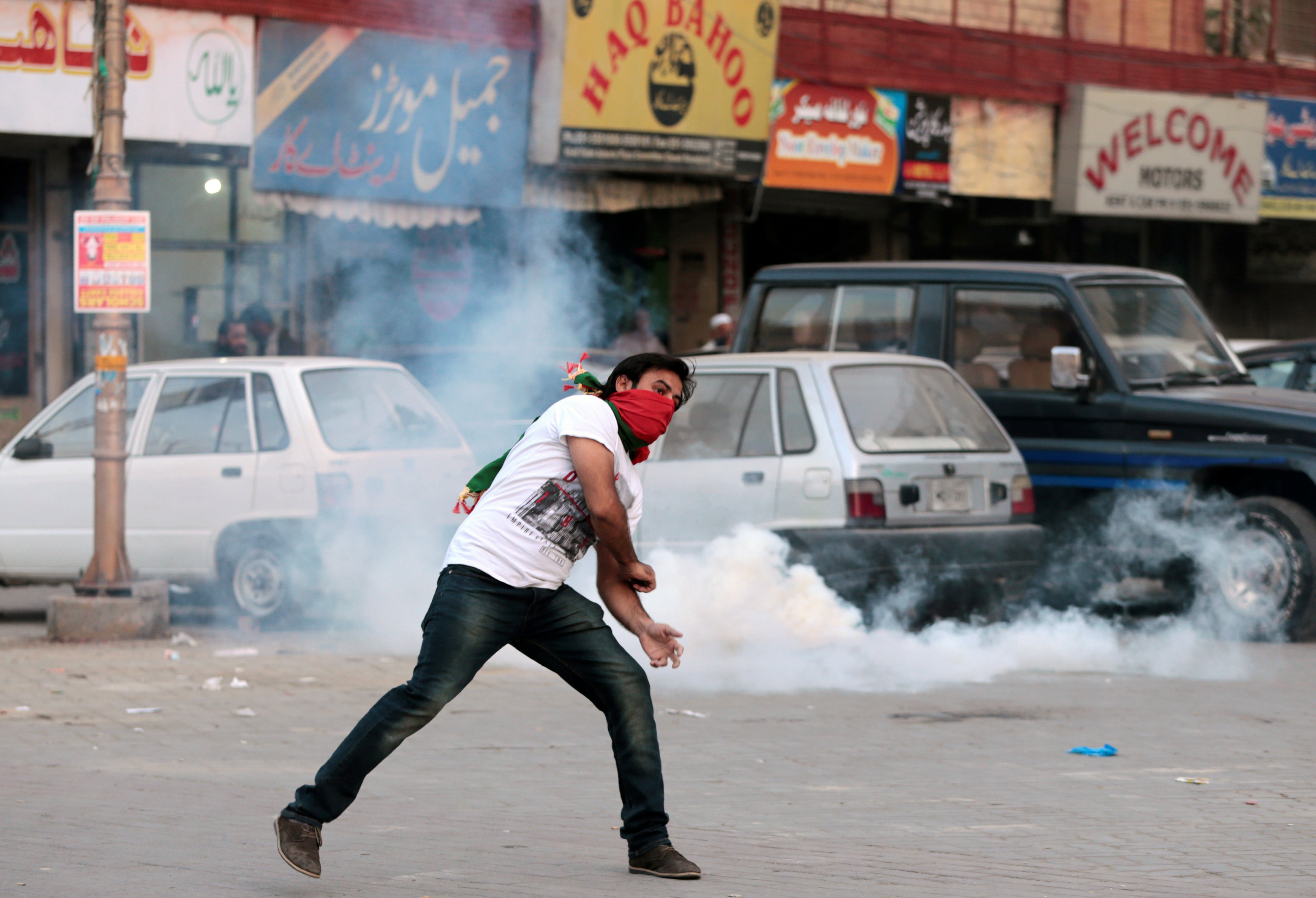 A protester throws stones at police during clashes in Rawalpindi, Pakistan October 28, 2016.