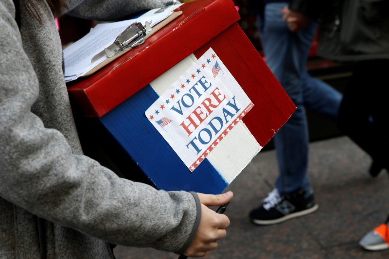 An election volunteer holds a box outside Trump Tower in the Manhattan borough of New York City,