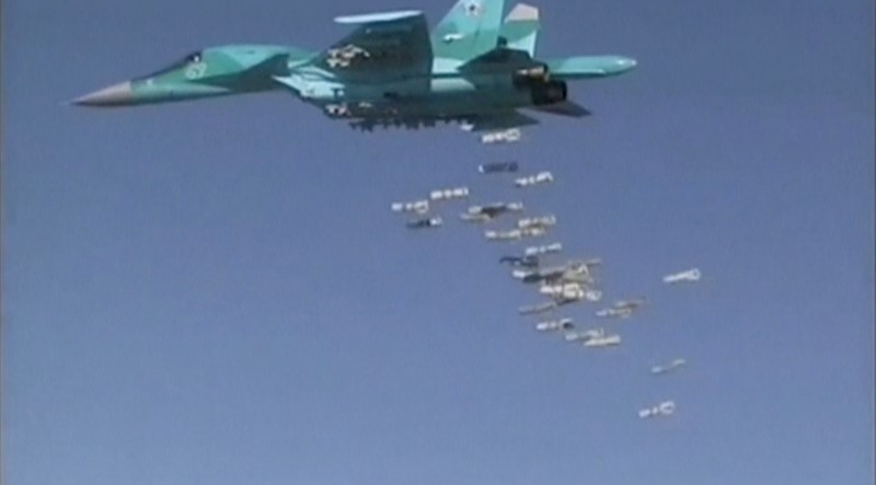A still image, taken from video footage and released by Russia's Defence Ministry on August 18, 2016, shows a Russian Sukhoi Su-34 fighter-bomber based at Iran's Hamadan air base dropping off bombs in the Syrian province of Deir ez-Zor. Ministry of Defence of the Russian Federation/