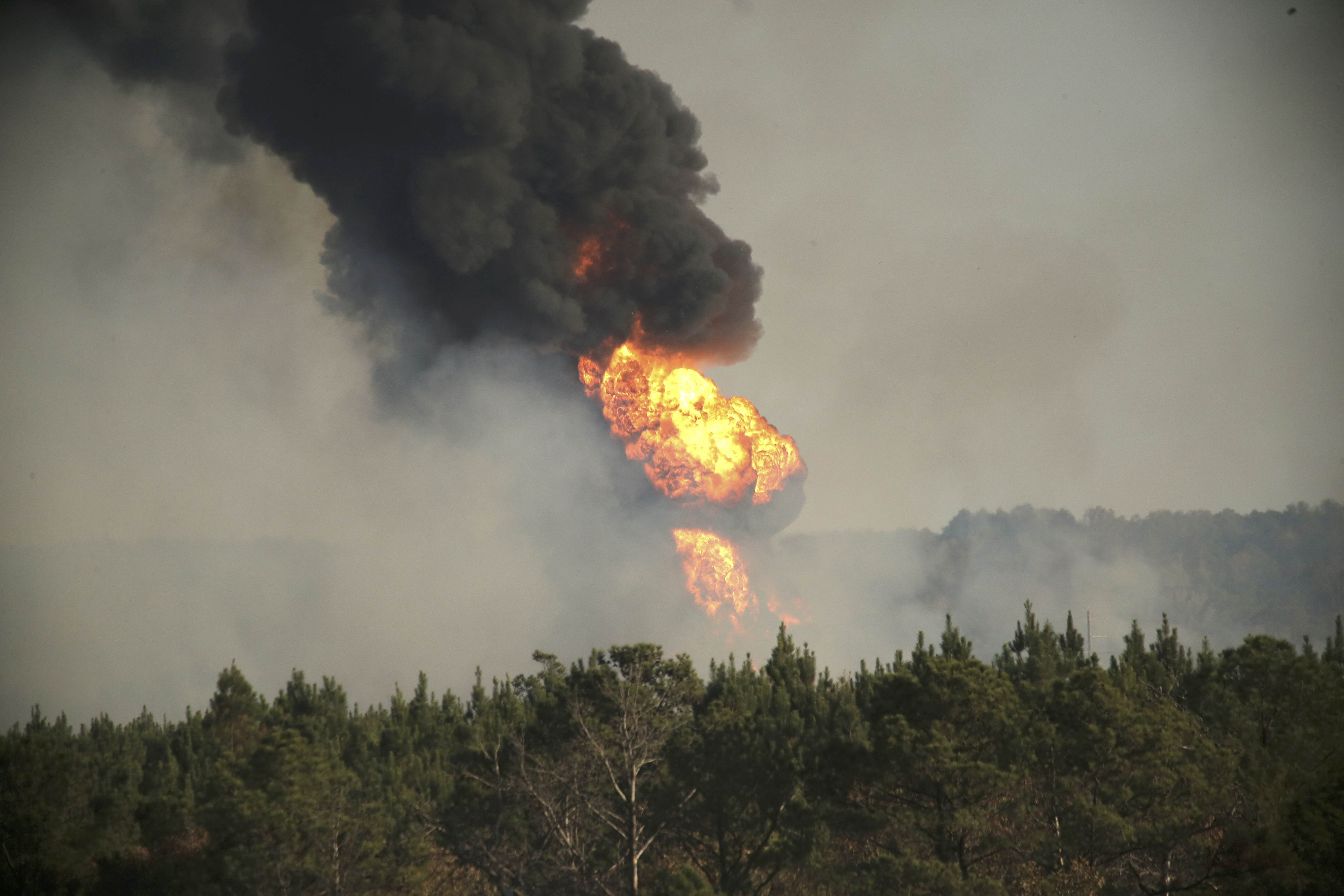 Flames shoot into the sky from a gas line explosion in western Shelby County, Alabama, U.S.,