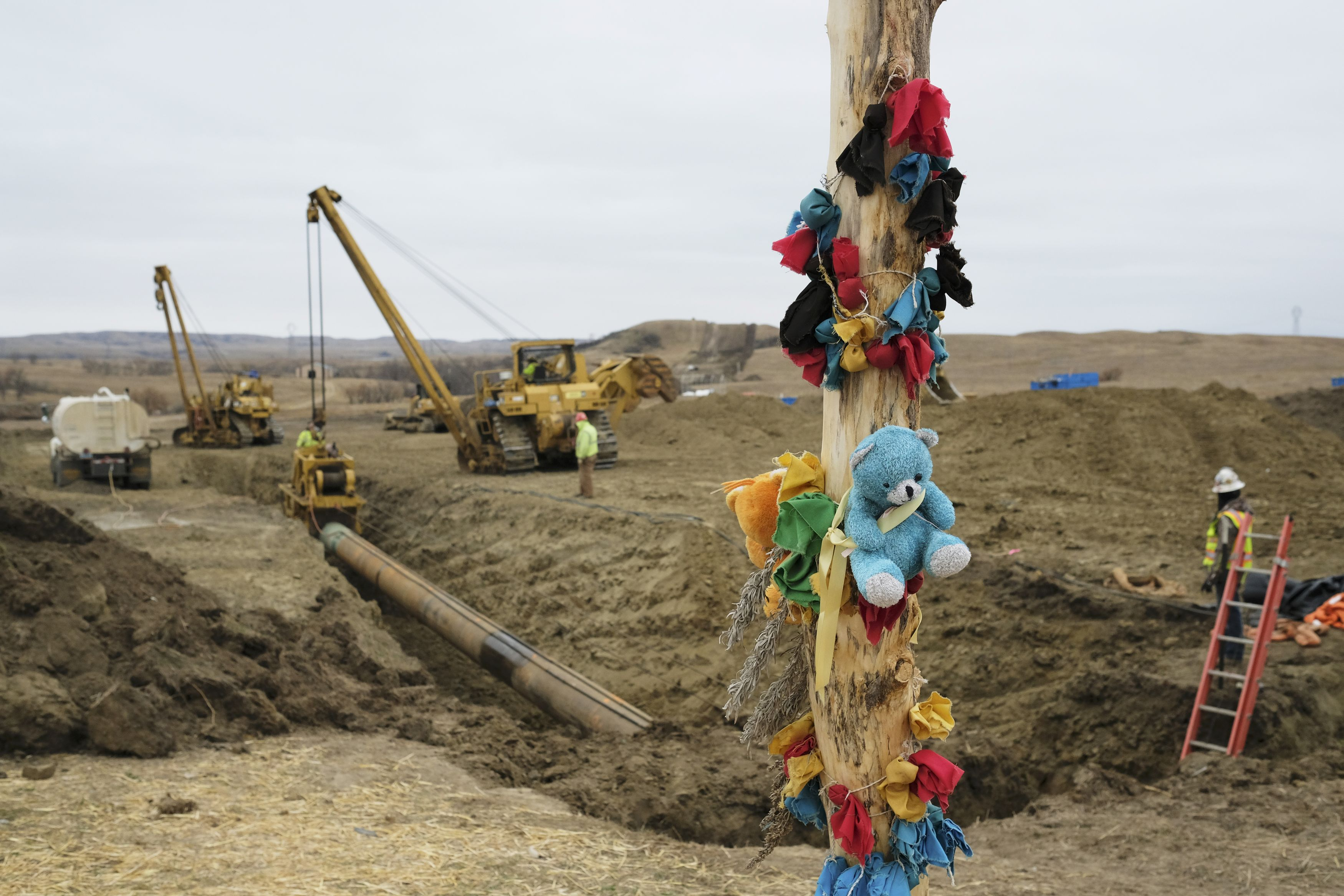 A log adorned with colorful decorations remains at a Dakota Access Pipeline protest encampment as construction work continues on the pipeline near the town of Cannon Ball, North Dakota, U.S.,