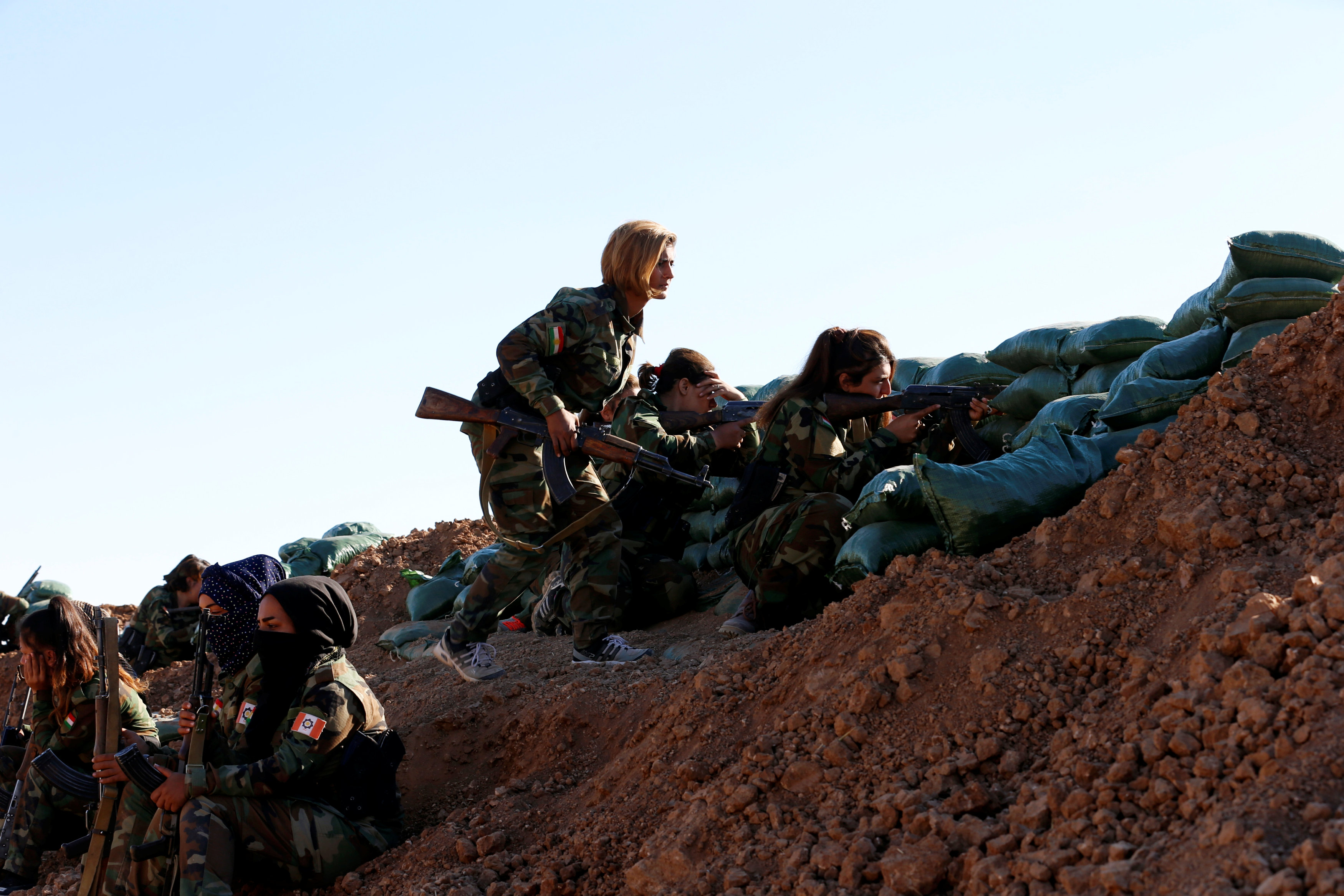 Iranian-Kurdish female fighters take position during a battle with Islamic State militants in Bashiqa, near Mosul, Iraq