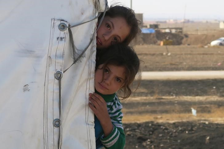 Displaced Iraqi girls are seen in Kokjali village near Mosul, during an operation against Islamic State militants, Iraq,