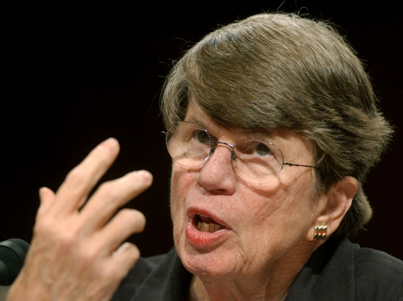 Former U.S. Attorney General Janet Reno testifies before the 9-11 commission in the Hart Senate office building on Capitol Hill in Washington